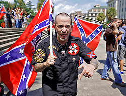 "Members of the Loyal White Knights of the Ku Klux Klan from Pelham, N.C., argue with members of the crowd at the State House Saturday, July 18, 2015 in Columbia. zlaup ""Confederate Flag"""
