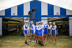 © Licensed to London News Pictures. 04/07/2018. Henley-on-Thames, UK. Rowers from St Jospeh's Nudgee College Rowing Club gather Ron day one of the Henley Royal Regatta, set on the River Thames by the town of Henley-on-Thames in England. Established in 1839, the five day international rowing event, raced over a course of 2,112 meters (1 mile 550 yards), is considered an important part of the English social season. Photo credit: Ben Cawthra/LNP