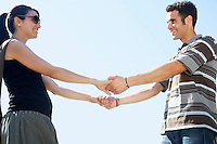 Young couple holding hands portrait