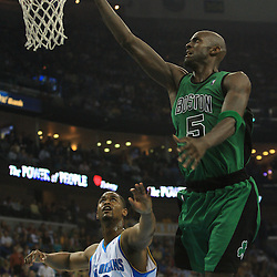 11 February 2009:  Boston Celtics forward Kevin Garnett (5) shoots over New Orleans Hornets center Hilton Armstrong (12) during a NBA game between the Boston Celtics and the New Orleans Hornets at the New Orleans Arena in New Orleans, LA.
