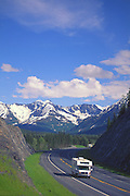 Alaska. Visitors travel along the Seward Highway, Chugach Mts in background.