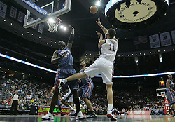 Apr 11; Newark, NJ, USA; New Jersey Nets center Brook Lopez (11) is fouled by Charlotte Bobcats center Kwame Brown (54) during the first half at the Prudential Center.