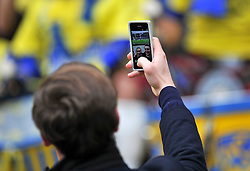 A general view of a couple posing for a selfie - Photo mandatory by-line: Patrick Khachfe/JMP - Mobile: 07966 386802 02/05/2015 - SPORT - RUGBY UNION - London - Twickenham Stadium - ASM Clermont Auvergne v RC Toulon - European Rugby Champions Cup Final