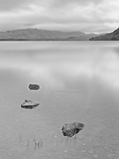 On the shore of Loch Maree at Slattadale, looking toward Slioch in the distance.<br /> <br /> As I was here, there was a fellow cooking breakfast a few yards along the little beach - the smell of fried bacon rashers wafted past on the breeze...