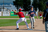 KELOWNA, BC - JULY 17: Ryan Altenberger #1 of the Wenatchee Applesox returns to first base as Conagher Sands #22 of the Kelowna Falcons receives the ball from the pitcher at Elks Stadium on July 17, 2019 in Kelowna, Canada. (Photo by Marissa Baecker/Shoot the Breeze)