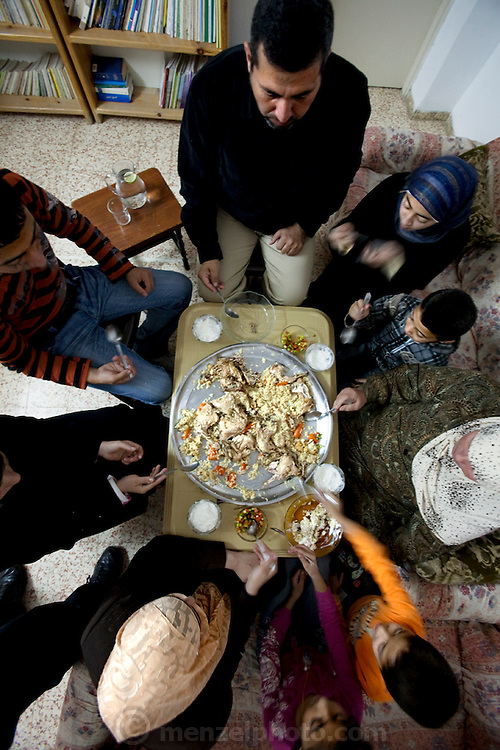 Abdul-Baset Razem and his family having a mid day meal in the Palestinian village Abu Dis in East Jerusalem. (From the book What I Eat: Around the World in 80 Diets.)