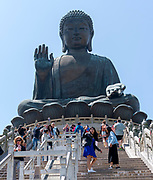 Tian Tan Buddah (Big Buddah) and tourists at Po Lin Monastery, Lantau Island, Hong Kong.