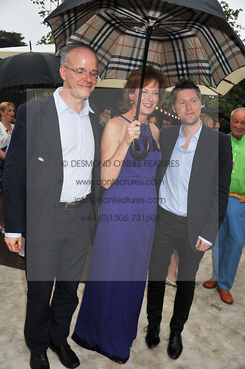 Left to right, HANS ULRICH OBRIST,  JULIA PEYTON-JONES and CHRISTOPHER BAILEY at the annual Serpentine Gallery Summer Party sponsored by Burberry held at the Serpentine Gallery, Kensington Gardens, London on 28th June 2011.