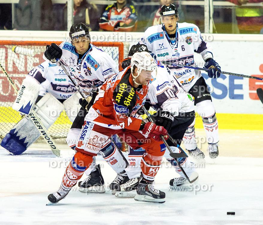 19.09.2014, Stadthalle, Klagenfurt, AUT, EBEL, EC KAC vs Fehervar AV19, 4. Runde, im Bild Rajna Miklos (Fehervar AV19, #31), Csaba Kovacs (Fehervar AV19, #21), Jamie Lundmark (EC KAC, #74), Isvan Bartalls (Fehervar AV19, #10), Sziranyi Bnce (Fehervar AV19, #6) // during the Erste Bank Icehockey League 4th round match betweeen EC KAC and Fehervar AV19 at the City Hall in Klagenfurt, Austria on 2014/09/19. EXPA Pictures © 2014, PhotoCredit: EXPA/ Gert Steinthaler
