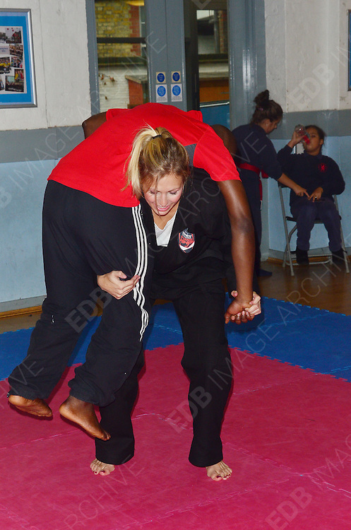 23.OCTOBER.2012. LONDON<br /> <br /> OLYMPIC JUDO SILVER MEDALIST GEMMA GIBBONS, AS A PART OF THE AIM HIGH INITIATIVE, TUTORS A CLASS FROM CHRIST CHURCH PRIMARY SCHOOL IN THE ART OF JUDO WITH SOME ADDED NINJA SKILLS..<br /> <br /> BYLINE: JOE ALVAREZ/EDBIMAGEARCHIVE.CO.UK<br /> <br /> *THIS IMAGE IS STRICTLY FOR UK NEWSPAPERS AND MAGAZINES ONLY*<br /> *FOR WORLD WIDE SALES AND WEB USE PLEASE CONTACT EDBIMAGEARCHIVE - 0208 954 5968*