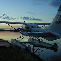 Cessna 206 on floats docked in Northern Alberta's bush country.