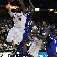 Central Florida guard Marcus Jordan (5) drives to the basket against Memphis guard Will Barton (5) during a Conference USA NCAA basketball game between the Memphis Tigers and the Central Florida Knights at the UCF Arena on February 9, 2011 in Orlando, Florida. Memphis won the game 63-62. (AP Photo: Alex Menendez)