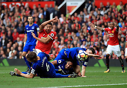 Manchester United's Jesse Lingard goes down in the area under the challenge of Everton's Ashley Williams (centre)