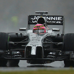 FORMULA 1 SANTANDER BRITISH GRAND PRIX .. Jenson Button in the wet third free practice session...(c) STEPHEN LAWSON | SportPix.org.uk