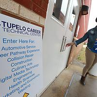 Tupelo High School teacher Cerritos Johnson gets ready to open the doors for Tuesday's career fair at the schools career-technical center.