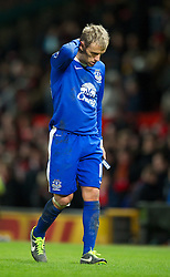 MANCHESTER, ENGLAND - Sunday, February 10, 2013: Everton's captain Phil Neville walks off dejected after losing 2-0 to Manchester United during the Premiership match at Old Trafford. (Pic by David Rawcliffe/Propaganda)