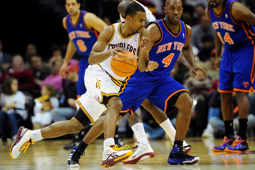 Feb. 25, 2011; Cleveland, OH, USA; Cleveland Cavaliers point guard Ramon Sessions (3) drives around New York Knicks point guard Chauncey Billups (4) during the first quarter at Quicken Loans Arena. Mandatory Credit: Jason Miller-US PRESSWIRE