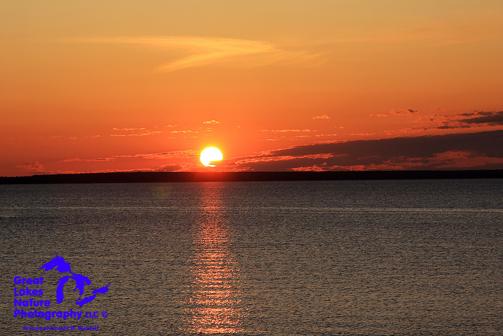 This image captures the warm glow of the morning sun, as it rises over Bois Blanc Island and Lake Huron. The credit for this terrific photograph, taken from Mackinaw City, Michigan, goes to my son, Ethan, who enjoys the midwest out-of-doors much like I do.