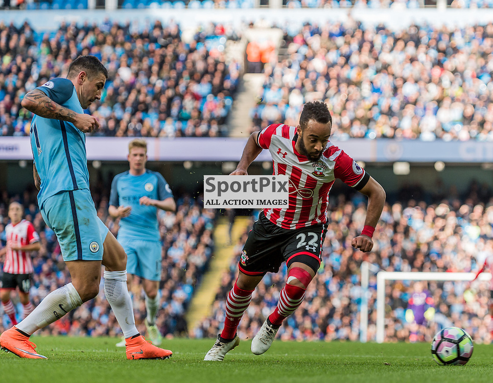 Manchester City defender Aleksandar Kolarov (11) and Southampton midfielder Nathan Redmond (22) chase a loose ball in the Premier League match between Manchester City and Southampton<br /> <br /> (c) John Baguley | SportPix.org.uk