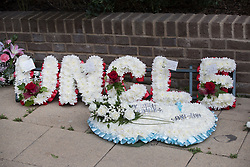 © Licensed to London News Pictures. 29/06/2017. London, UK. Floral tributes are seen ahead of the funeral of Grenfell fire victim Tony Disson. Mr Disson is one of only a handful of the 80 victims to have been identified and named so far. Photo credit: Peter Macdiarmid/LNP