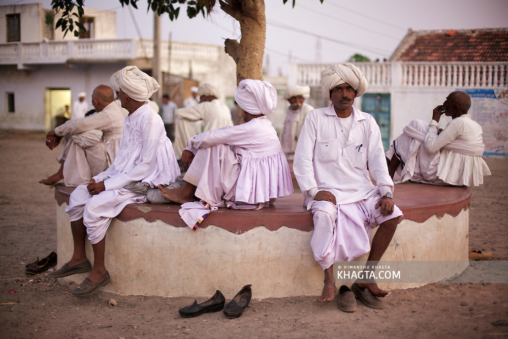 Local Village people sit together under a tree in a village near Bhuj, Gujarat.