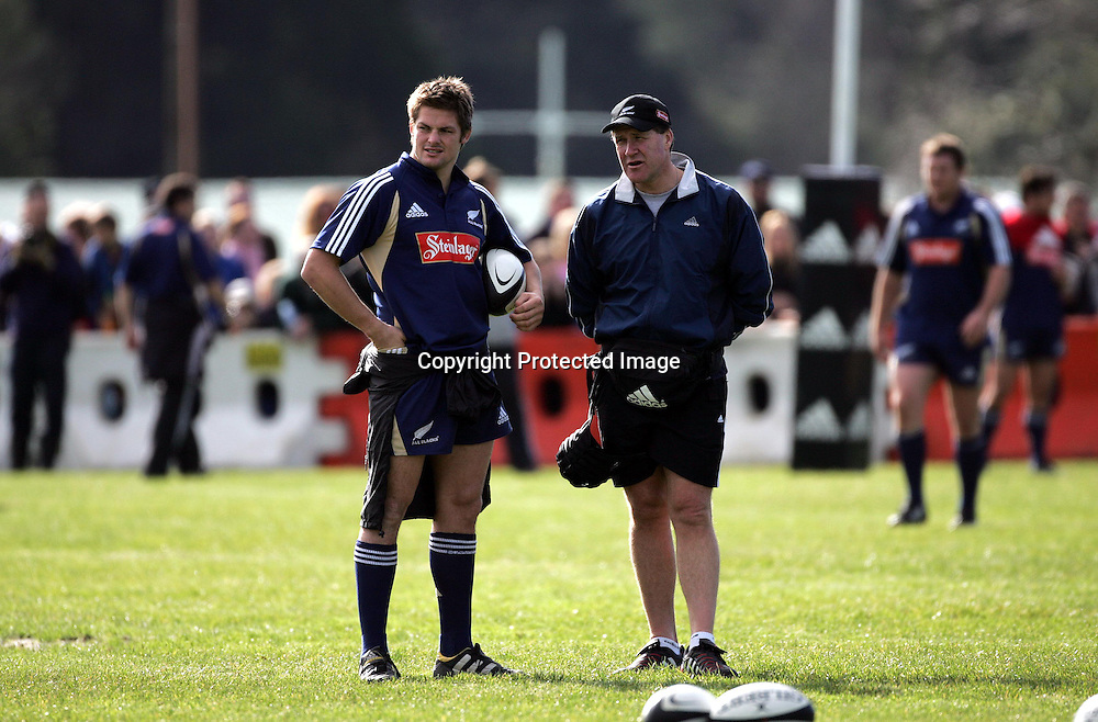 Richard McCaw and All Black doctor Graham Paterson during the All Blacks training session at Silverdale United RFC, North of Auckland, New Zealand, Wednesday 7th July 2004. The All Blacks play the Pacific Islanders on Saturday.<br />