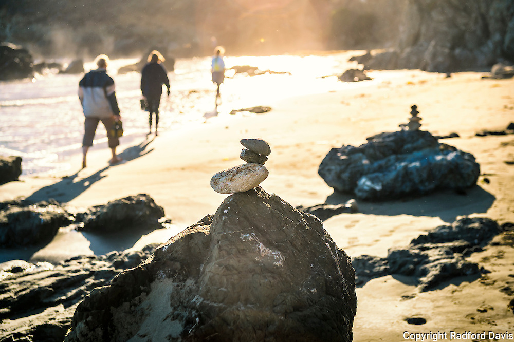 Rock cairn on the beach in San Simeon, California, near sunset.