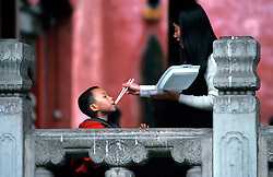 CHINA BEIJING APR99 - A Chinese mother feeds her young son in a park in the Imperial Palace compound. ..jre/Photo by Jiri Rezac..© Jiri Rezac 1999..Contact: +44 (0) 7050 110 417.Mobile:  +44 (0) 7801 337 683.Office:  +44 (0) 20 8968 9635..Email:   jiri@jirirezac.com.Web:    www.jirirezac.com..© All images Jiri Rezac 1999 - All rights reserved.