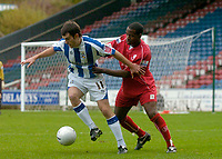Photo: Glyn Thomas.<br />Huddersfield Town v Welling United. The FA Cup. 06/11/2005.<br />Huddersfield's Danny Schofield (L) holds off a challenge from Leon Solomon.