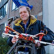NLD/Laren/20130204 - Fotograaf Rene Oudshoorn voor het politieburo Laren nadat hij aangehouden was voor het fotograferen met een mini rc helicopter op Vredelaan bij huis directeur SNS