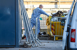 © Licensed to London News Pictures. 05/08/2018. LONDON, UK. A forensics officer at work as a police cordon is set up in Cambridge Gardens, Kingston-Upon-Thames.  A murder investigation has been launched after a man in his 20s was fatally stabbed there in the early hours of Sunday morning.   Investigations are ongoing.  Photo credit: Stephen Chung/LNP