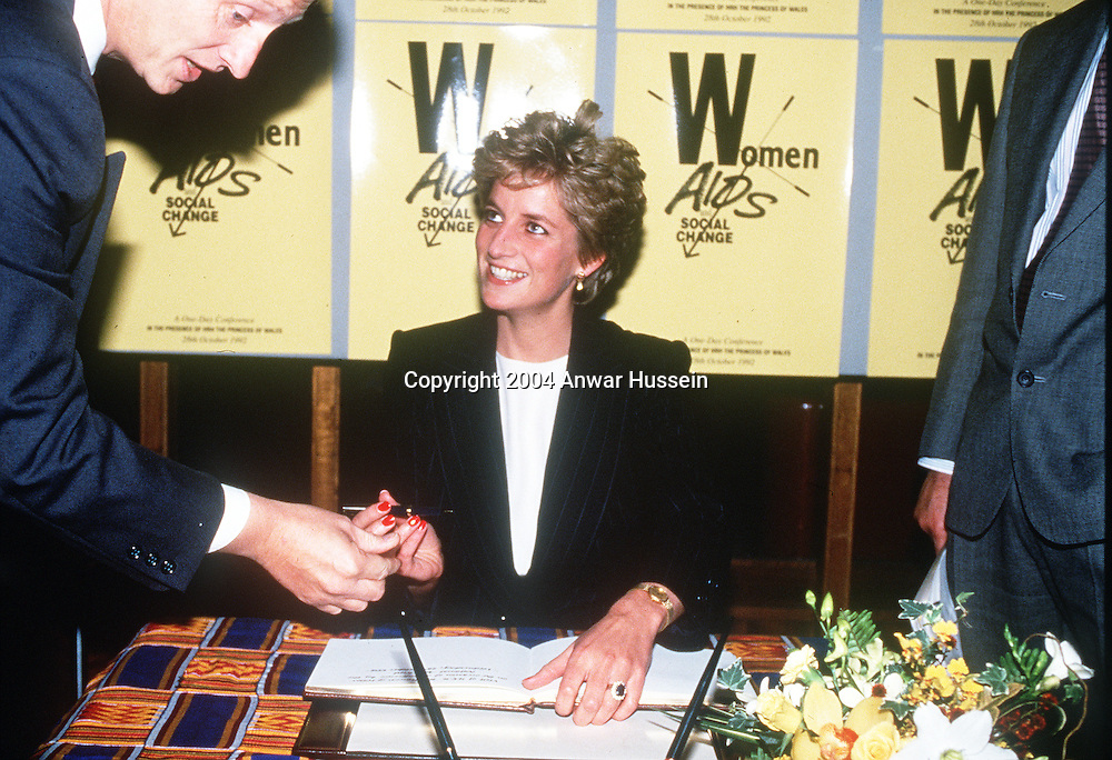 LONDON, ENGLAND - APRIL 9:  (FILE PHOTO)  Diana, Princess of Wales signs the guestbook at the Womens Aids and Social Change Foundation in this 1987 file photo in London, England.  (Photo by Anwar Hussein)