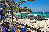 Man enjoys his lunch at a seaside restaurant in the Italian resort island of Capri.