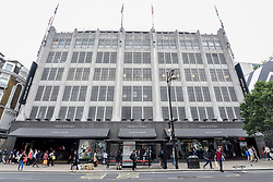 © Licensed to London News Pictures. 07/06/2018. LONDON, UK.  People walk by the flagship store of House of Fraser in Oxford Street.  It is reported that the department store chain House of Fraser plans to close 31 of its 59 stores, with 6,000 jobs affected.  The flagship store will close in early 2019 as a result of the rescue deal which requires approval by 75% of its creditors as part of company voluntary arrangements.  Photo credit: Stephen Chung/LNP