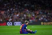 Leo messi is seriously injured of the left leg during the La Liga match between Barcelona and Atletico Madrid at Camp Nou, Barcelona, Spain on 21 September 2016. Photo by Eric Alonso.