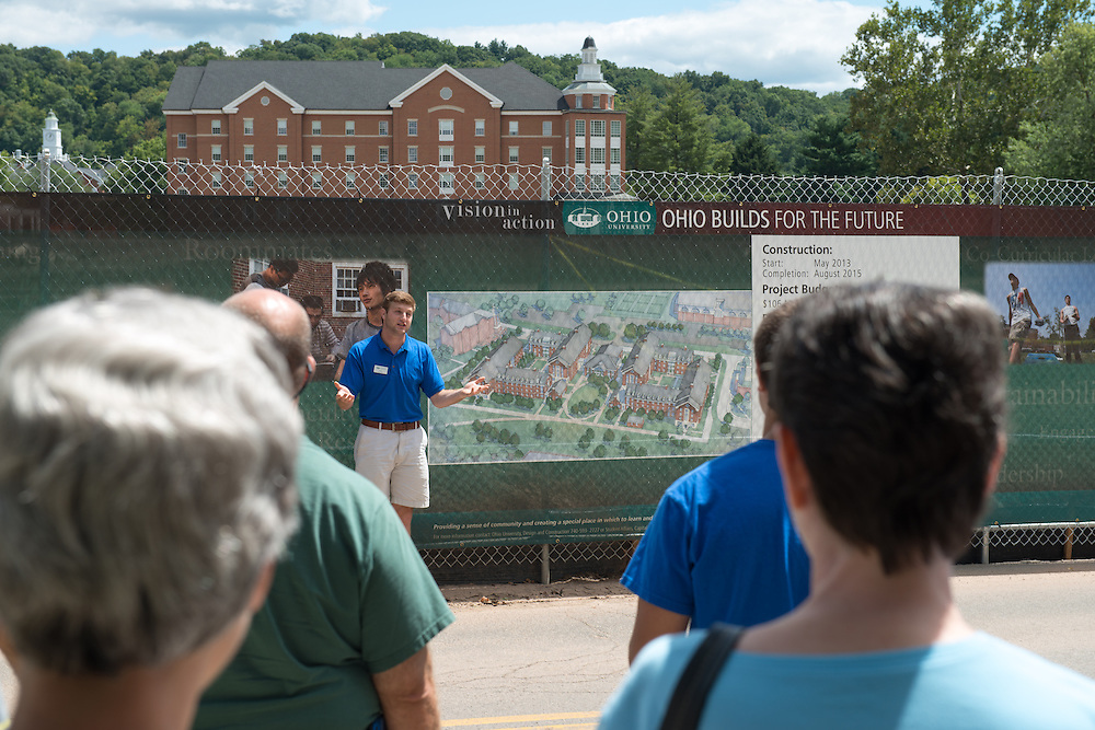 A guide presents the new residential housing construction plan during a tour of East and South Greens. Photo by Ben Siegel