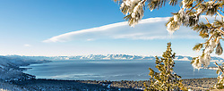 """Icicles Above Lake Tahoe 1"" - Stitched panoramic photograph of icicles hanging from a tree above a snowy and blue Lake Tahoe."