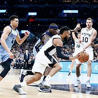04 April 2017: San Antonio Spurs guard Patty Mills (8) drives past Memphis Grizzlies guard Wade Baldwin IV (4) and Memphis Grizzlies forward Zach Randolph (50) during the San Antonio Spurs 95-89 OT victory over the Memphis Grizzlies, at the AT&T Center, San Antonio, Texas, USA.