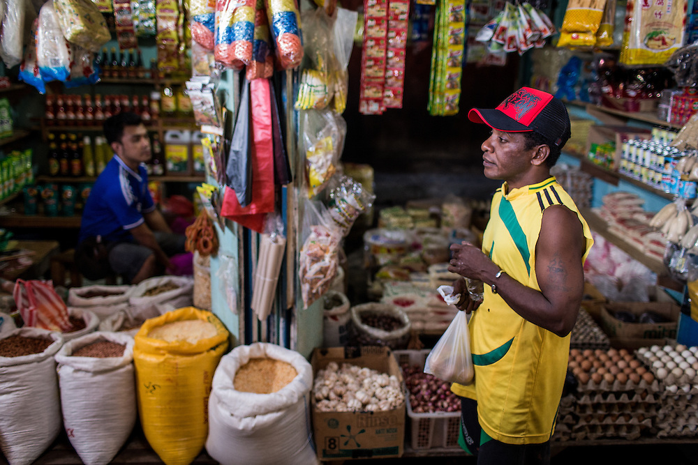 Yosua shops for cooking ingredients at a nearby market.