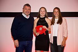 NEWPORT, WALES - Saturday, May 19, 2018: Hayley Hoare is presented with her Under-16's cap by Osian Roberts (left) and Lauren Dykes (right) during the Football Association of Wales Under-16's Caps Presentation at the Celtic Manor Resort. (Pic by David Rawcliffe/Propaganda)