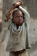 Portrait of a boy with dirty, worn t-shirt. Northern Ghana, Thursday November 13, 2008.