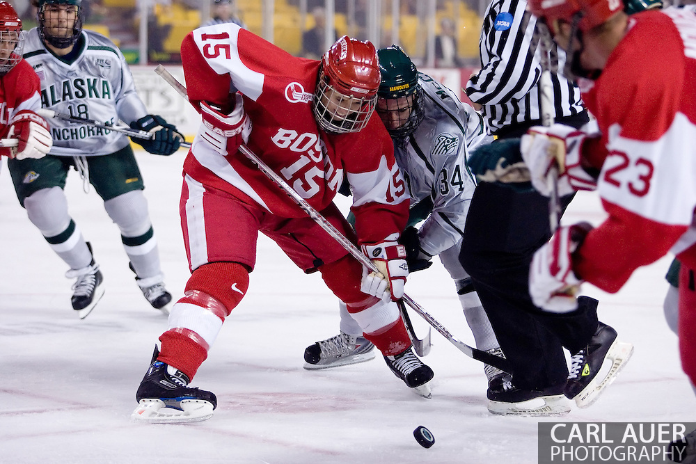October 13, 2007 - Anchorage, Alaska:  John McCarthy (15) of the Boston University Terriers faces off with Brad McCabe (34) of the University of Alaska-Anchorage Seawolves during game 4 of the Nye Frontier Classic at the Sullivan Arena.  UAA and BU would tie 4-4 giving Robert Morris University the title of Nye Frontier Classic Champion.