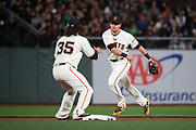 San Francisco Giants second baseman Joe Panik (12) flips the ball to San Francisco Giants shortstop Brandon Crawford (35) for a double play against the Los Angeles Dodgers in the fourth inning at AT&T Park in San Francisco, California, on April 24, 2017. (Stan Olszewski/Special to S.F. Examiner)