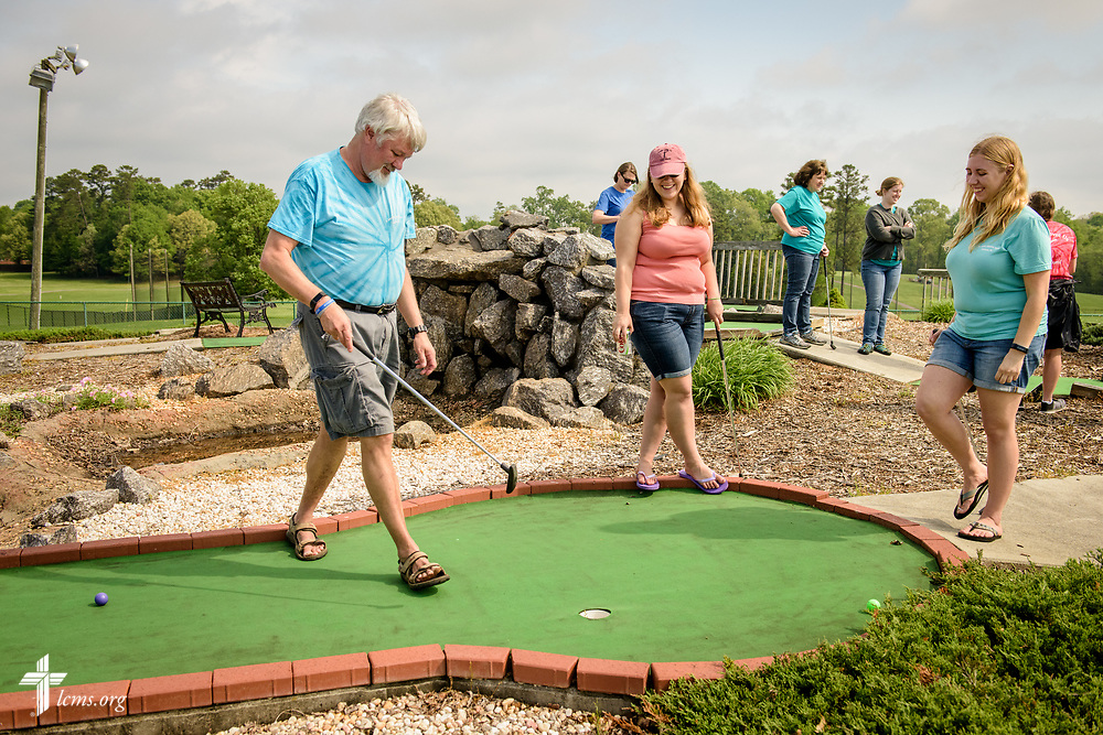 Joanna Johnson (right), new GEO missionary to Taiwan, plays mini golf with her sister Mary Johnson and her father, the Rev. Scott Johnson, pastor of St. John's Lutheran Church, Conover, N.C, during a fundraiser for a short-term parish mission trip to Alaska at the Hampton Heights Golf Club on Saturday, April 22, 2017, in Hickory, N.C. Johnson said she'll miss time spent with her family when she leaves for Taiwan as a missionary. LCMS Communications/Erik M. Lunsford