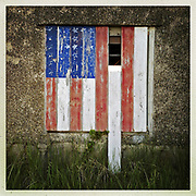 DAY TWO of SEVEN: A 12x12 archival Type C print of &quot;Boarded Flag (Biddeford Pool ME)&quot; will be available for purchase until July 16th. This print will be in an edition of 7 for $49.49. <br /> <br /> A flag has been painted on the boards covering a window on a garage in Biddeford Pool, Maine.