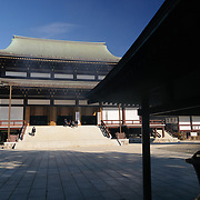 The Great Main Hall. At far right are incense sticks being burnt, with the smoke waftering across the middle of the frame. The Narita-san temple, also known as Shinsho-Ji (New Victory Temple), is Shingon Buddhist temple complex, was first established 940 in the Japanese city of Narita, east of Tokyo.