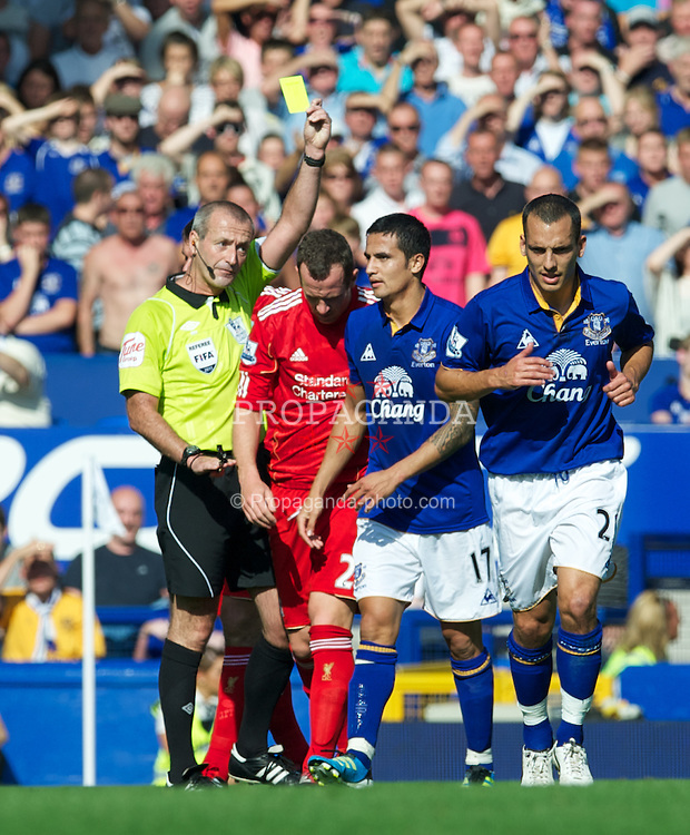 LIVERPOOL, ENGLAND - Saturday, October 1, 2011: Everton's Tim Cahill is shown the yellow card during the Premiership match against Liverpool at Goodison Park. (Pic by David Rawcliffe/Propaganda)