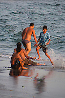 Boys playing on a beach in Candidasa, Bali, Indonesia