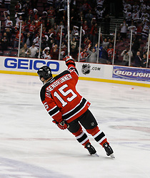 April 28, 2007; East Rutherford, NJ, USA; New Jersey Devils right wing Jamie Langenbrunner (15) gets the first star after his game winning goal during the second overtime period of game two of the 2007 NHL Eastern Conference semi-finals at Continental Airlines Arena in East Rutherford, NJ. The New Jersey Devils won 3-2 in the second overtime to even the series 1-1.