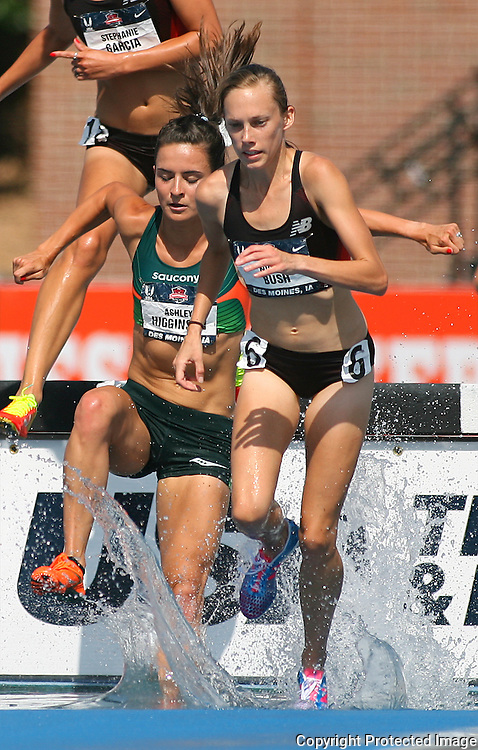 BUSH.HIGGINSON -13USA, Des Moines, Ia. -  Nicole Bush and Ashley Higginson battled late in the steeplechase. Photo by David Peterson